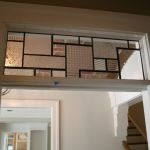 Custom patterned stained glass panel for over doorway