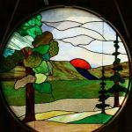 Sunset in the forest stained glass window