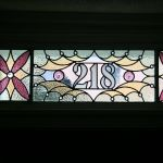 Custom stained glass window with street number