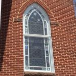 Custom shaped protective stained glass window coverings