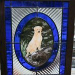 A stained glass panel with the portrait of family's dog