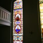 After restoring a tall stained glass window
