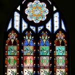 A restoration of a large, complex stained glass window